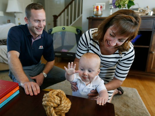 Pat and Kelly Coleman with son Evan, 10 months.