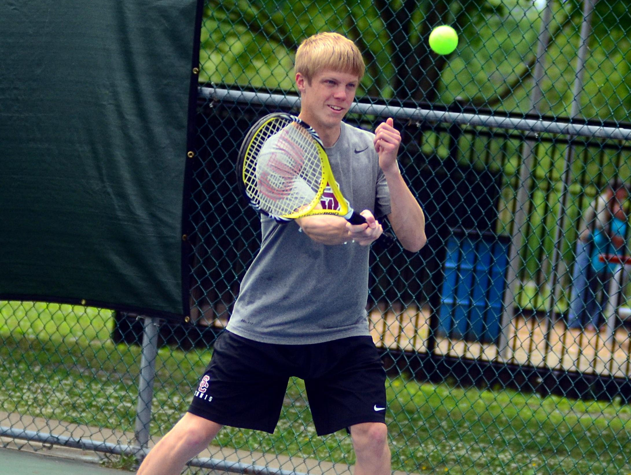 Station Camp High senior Nathan Watson returns a second serve during his first-round singles match on Tuesday at the District 9-AAA Individual Tennis Tournament. Watson finished runner-up to Hendersonville senior Kato Richardson and qualified for the Region 5-AAA Tournament.