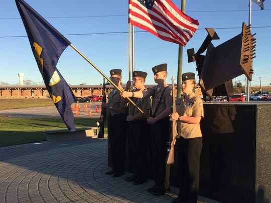 Chambersburg Area Senior High School's Naval Junior ROTC Color Guard  at the Franklin County Veterans and 9/11 Memorial Park Sunday.
