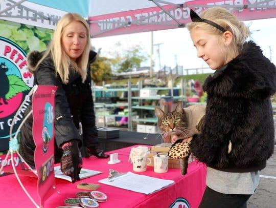 Lisa Jackson shows Skinny Pete's Gourmet Catnip to