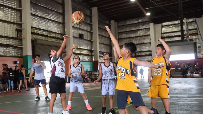 In this June 30 file photo, the Crusaders' Jaelyn Han (24) shoots a jump shot against the Yellowjackets Yellow during a Guam Youth Basketball Association game at Astumbo Gym.