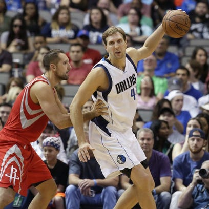 Dallas Mavericks forward Dirk Nowitzki (41), of Germany, is defended by Houston Rockets forward Ryan Anderson during the first half of an NBA preseason basketball game Wednesday, Oct. 19, 2016, in Dallas. (AP Photo/LM Otero)
