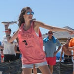 People enjoy The 2016 Flora-Bama Interstate Mullet Toss Saturday afternoon.