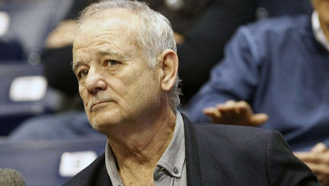 Actor Bill Murray sits in the stands at the Cintas Center before Xavier faces Villanova on  Wednesday, February 23, 2016. Murray's son Luke Murray is an assistant coach for Xavier.