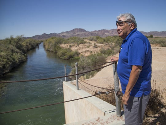 Chairman Dennis Patch of the Colorado River Indian Tribes stands next to a return flow structure on the Colorado River Reservation in western Arizona. Patch is looking at ways to be more efficient with the tribes' water and not return as much to the Colorado River.