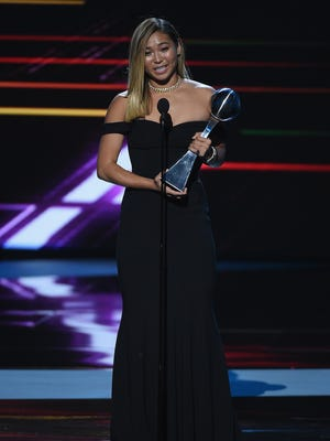 Olympic snowboarder Chloe Kim accepts the award for Best Female Athlete onstage at the ESPYS.