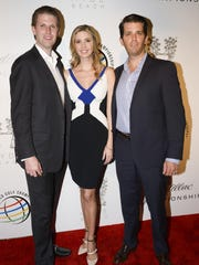 Eric Trump, Ivanka Trump, and Donald Trump, Jr. attend The Opening Drive Party at Hyde Beach on March 4, 2014 in Miami, Florida.