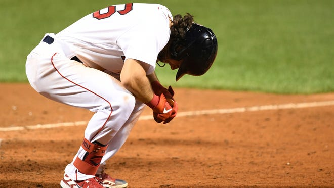 Boston's Andrew Benintendi reacts after being hit by a pitch Tuesday night during the eighth inning against Tampa Bay at Fenway Park.