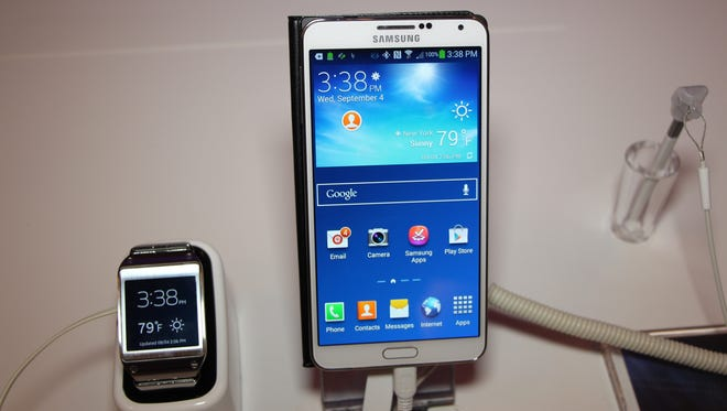 Samsung's Galaxy Gear smartwatch works in tandem with its Note 3 smartphone.