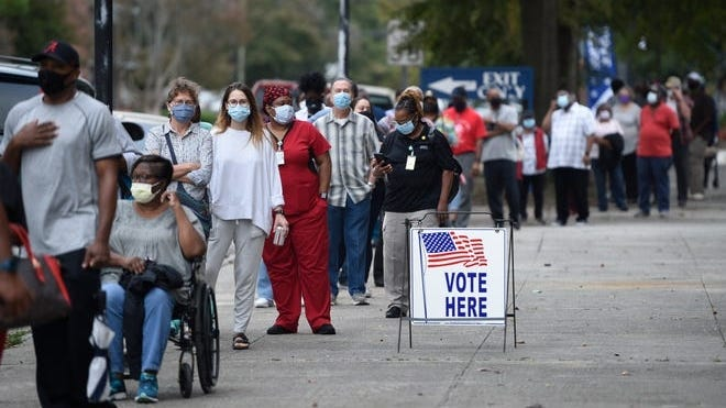 Voters wait to cast their ballots in Georgia Tuesday.