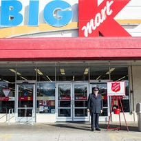 The Kmart on Brevard Road in Asheville is not becoming a Publix grocery store. A Salvation Army bell ringer stands in front of the store in this 2014 photo.
