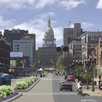 This artist's rendering shows what a bus rapid transit system would look like in downtown Lansing. The Meridian Township Board formally opposed the current plan for the system on Tuesday night.