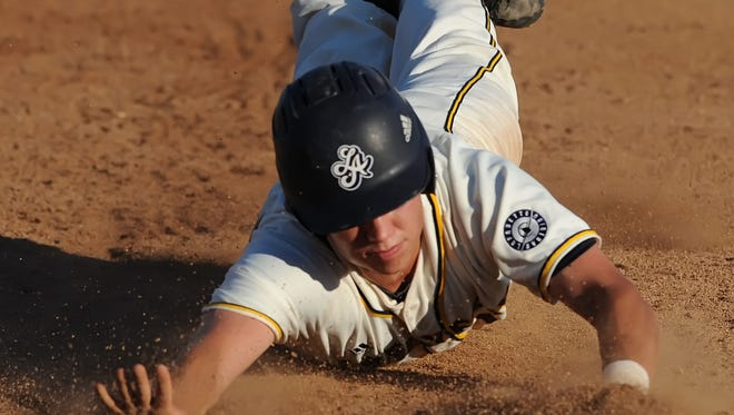 Catcher Mark Sluys dives for first to avoid a pickoff as the Aviators hosted the Sliders Tuesday night at Loeb Stadium.