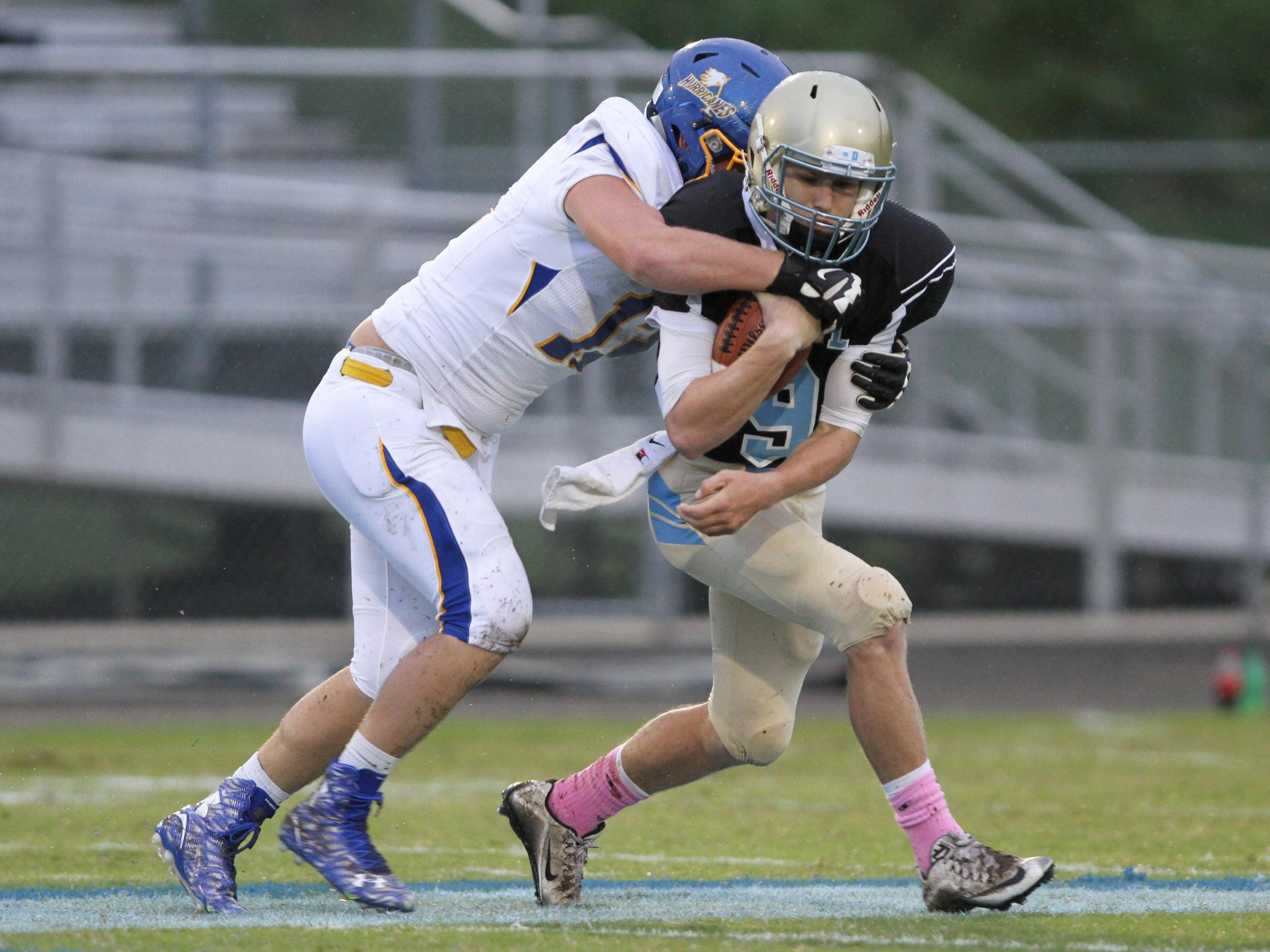 Chase McCroskey of Wren (12) tackles Ben Batson (9) of Daniel for a loss friday night at Daniel High School, October 2, 2015.