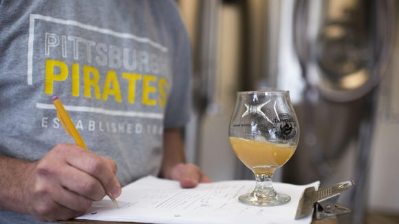 Brewmaster Jason Weissberg takes notes on a batch he's