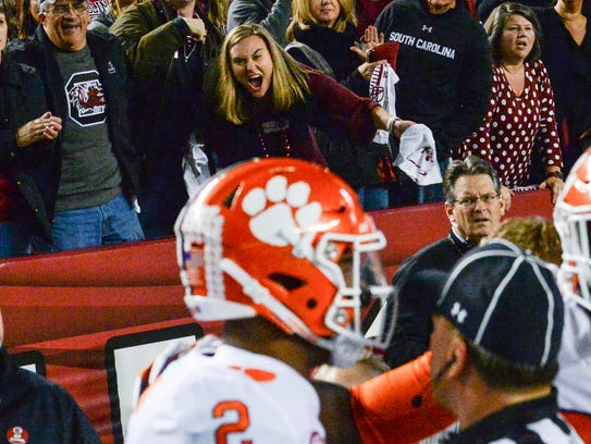 South Carolina fans yell toward Clemson quarterback