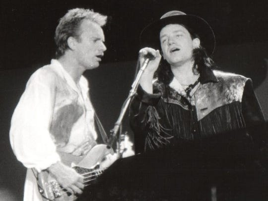 """Sting of The Police and U2'S Bono perform in 1986 on Amnesty International's """"A Conspiracy of Hope"""" tour."""