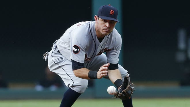Tigers second baseman Ian Kinsler fields a ground ball before throwing out Indians shortstop Francisco Lindor at first base during the first inning in Cleveland.