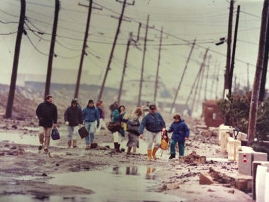 Evacuees head north Ocean Avenue in Sea Bright as they return to their homes on December 13, 1992, following the major nor'easter (File photo)