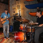 Jeff Sipe, right, and the duo who complete his trio.
