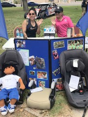 Jeca Jara, left, and Ana Barraza promoted child car safety seat awareness  and fittings during the 2018 Luna County Healthy Start Father's Day celebration at the Luna County Courthouse Park.