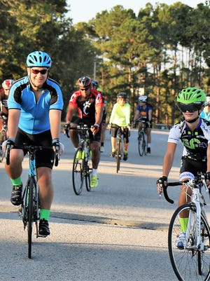 Cyclists make their way to the starting line Saturday during the 16th annual Bagels and Bluegrass Bicycle Century Tour, which began on the campus of Jackson State Community College.