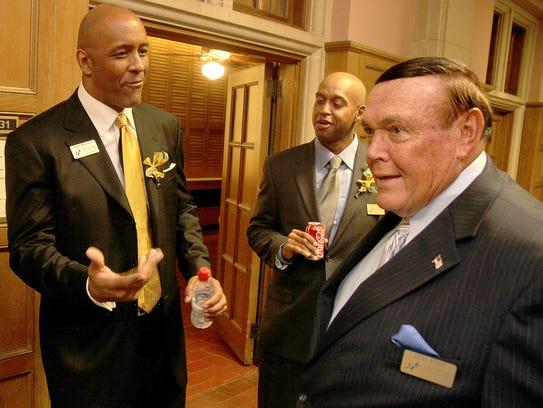 Former Purdue men's basketball coach Gene Keady (right)