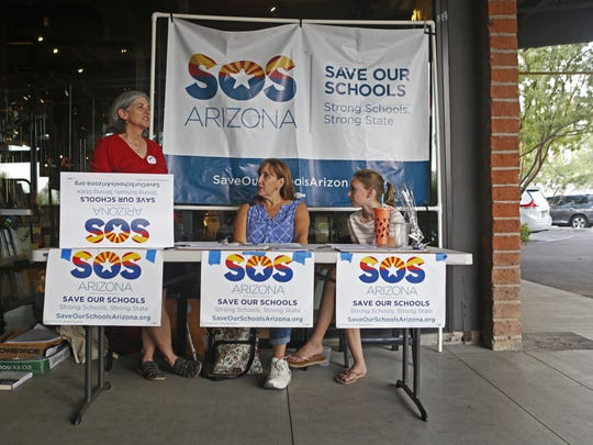 Save Our Schools Arizona volunteers Libby Goff (from