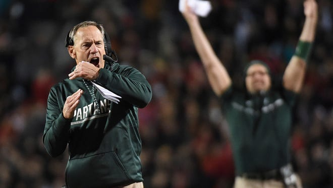 Michigan State's Mark Dantonio yells for a timeout against Maryland in the first half Saturday night in College Park, Md.