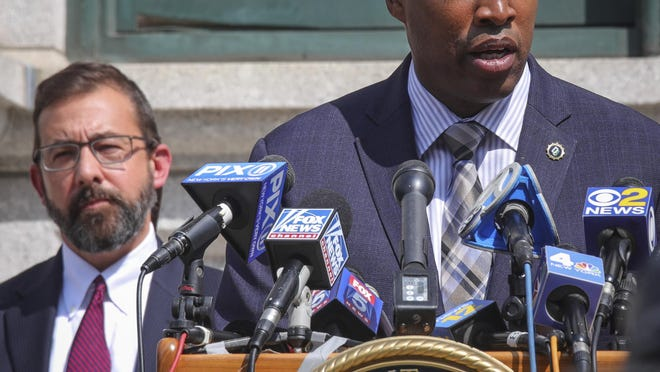 Acting United States Attorney Seth D. DuCharme, left, listens as N.Y. Chief of Detectives Rodney Harrison, speaks during a press conference where charges were announced against two individuals in the almost 18-year-old murder case of rap pioneer Jam Master Jay of Run-DMC, Monday, Aug. 17, 2020, in New York.