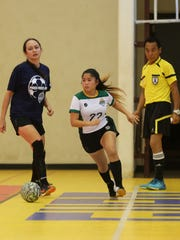 University of Guam Tritons' Shaeina Torres attempts