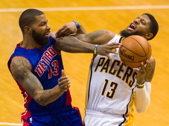 Pacers forward Paul George makes contact with Pistons