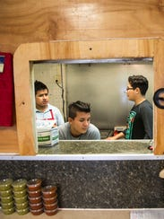 Teen Latinos work at a restaurant in Saluda, S.C.