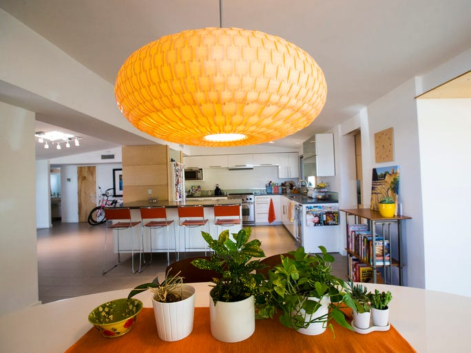 Dining area with a birch veneer light inside Tom Conner and Lauren Kelly's mid-century modern home in Phoenix.