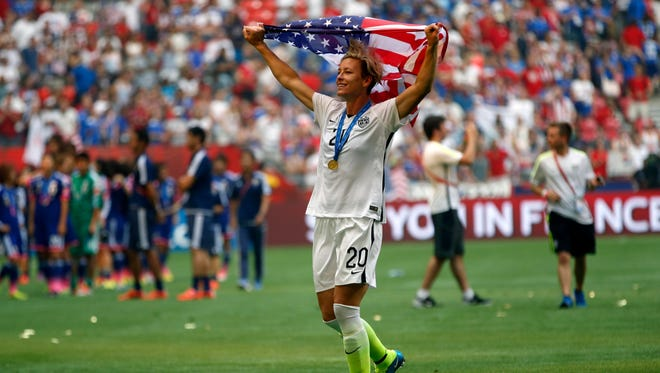 Our Lady of Mercy High School graduate Abby Wambach celebrates after winning the 2015 World Cup. Wambach retired later that year.