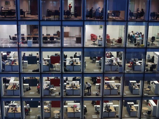 Workers In Offices At Night In London