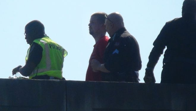 Jackson police save man on I-20 bridge who allegedly threatened to jump.