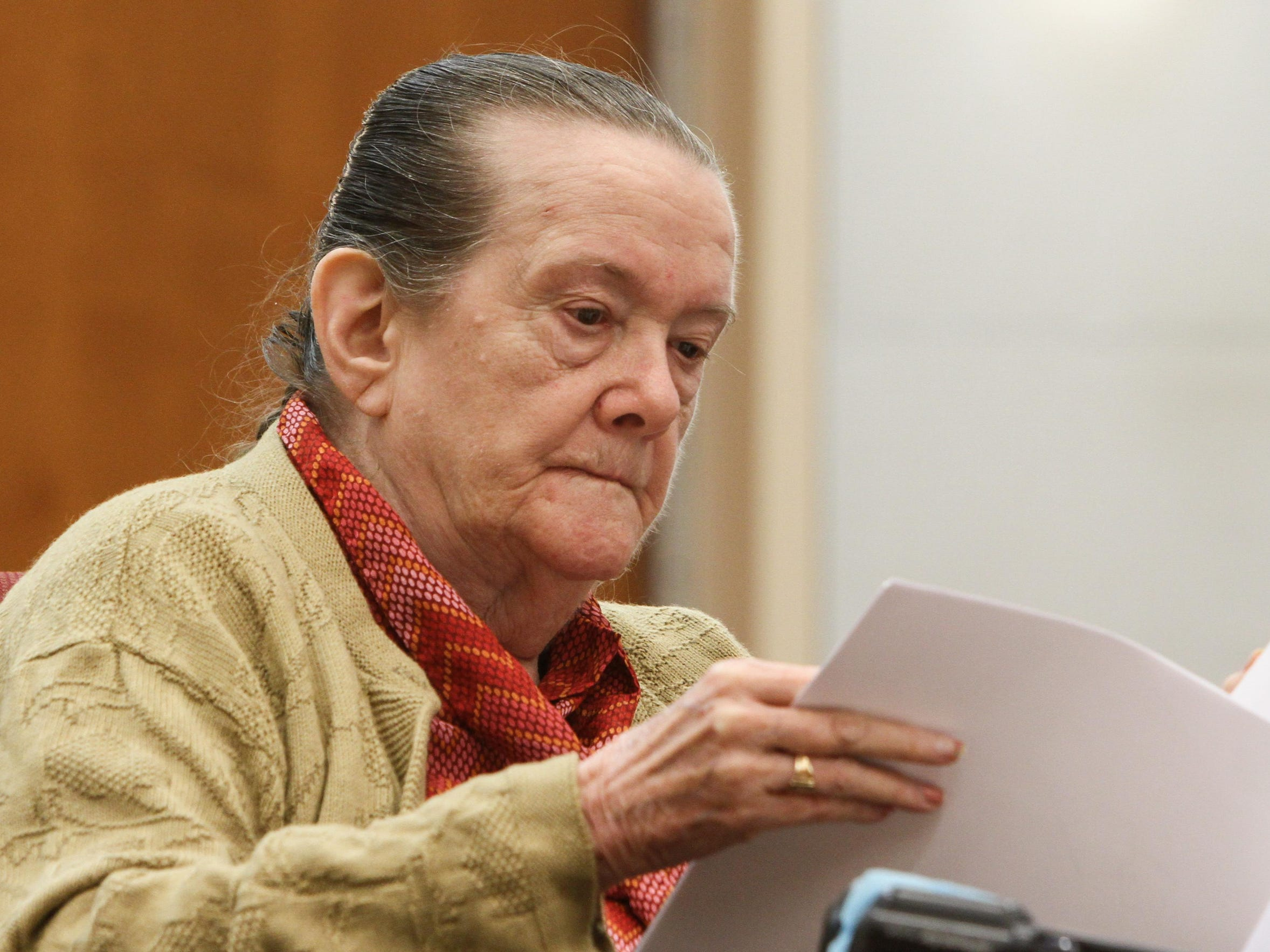 Helen Hugo reads legal documents in court.