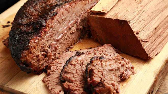 Wood chips add a sweet, smoky flavor to beef brisket.