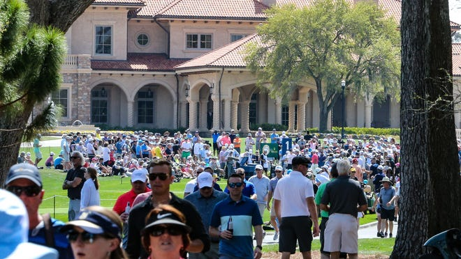 Fans mingle around the first tee of the Players Stadium Course at TPC Sawgrass on Thursday.