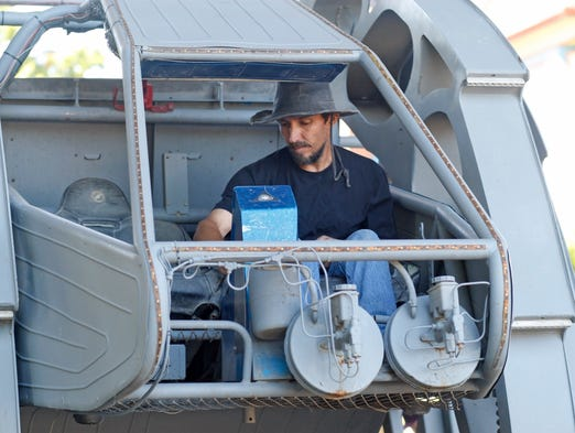 Martin Montesano sites in the cockpit before demonstrating how the Walking Beast moves during the Mini Maker Faire at the A.C Gilbert Discovery Village on Saturday, Aug. 9, 2014.