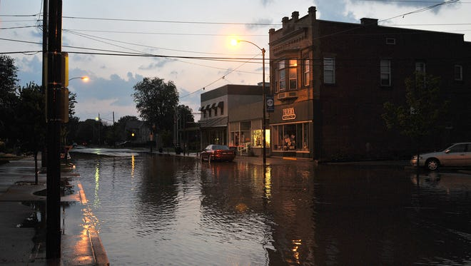 The 100 block of West Second Street was flooded with 3-4 inches of rainwater from a fast-moving thunderstorm that moved through the area in May 2014. With major upgrades planned for Second Street between Jefferson and Monroe, including new sewer and water lines, repaved roads, sidewalks and storm drains, residents and visitors can expect flooding after rain storms to decrease significantly.