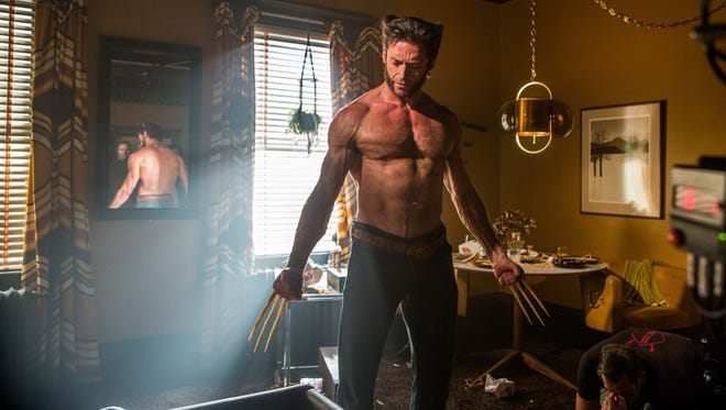 "Hugh Jackman as Wolverwine was back in ""X-Men: Days of Future Past,"" the No. 1 film over the holiday weekend."