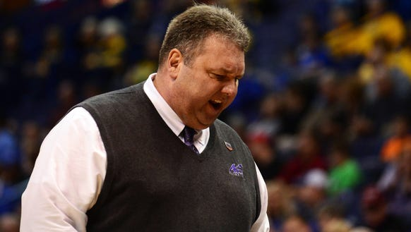 Evansville Aces head coach Marty Simmons reacts after