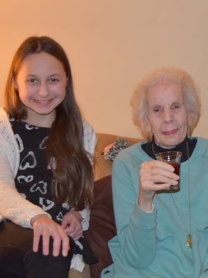 Olivia Leuci, 12, sits with her great grandmother, Adah Mazza, 94.