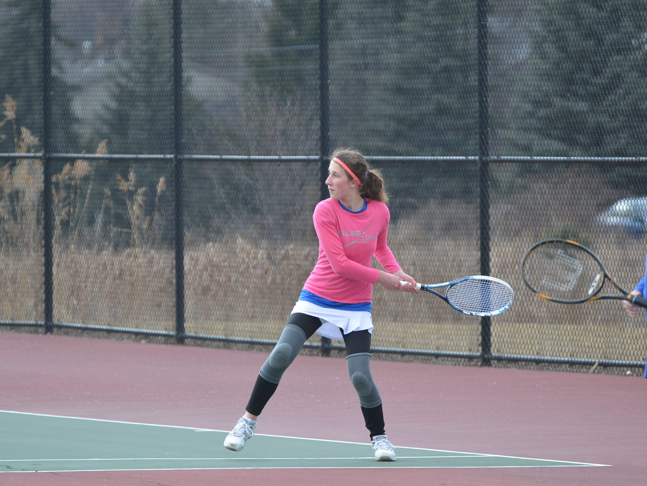 Getting ready to launch a return for Salem is 3 singles player Madison Kulik.
