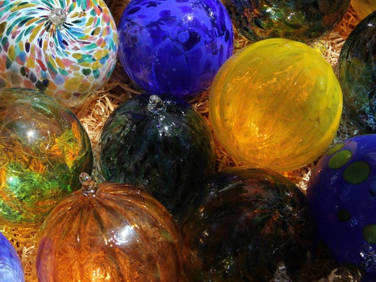 These handblown-glass ornaments by Michael Maddy are $15 each at the 66th annual Salem Art Fair & Festival.