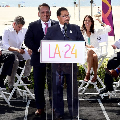 L.A. City Council President Herb Wesson along with L.A. City Councilmember Gilbert Cedillo speak in front of USOC CEO Scott Blackmun, LA 2024 Chairman Casey Wasserman, Olympian Janet Evens, announcer Al Michaels and Los Angeles Mayor Eric Garcetti during a press conference to officially launch a Los Angeles 2024 Olympic and Paralympic games bid at Annenberg Beach House.