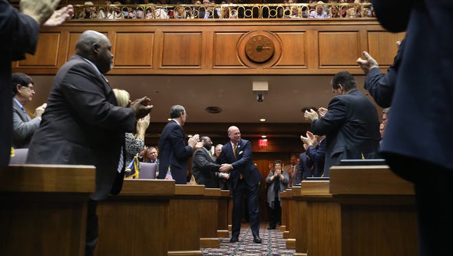 Legislation to allow more access to records of Indiana lawmakers' communications with each other won't advance in this session, but could be revived next year. Speaker of the House Brian Bosma, R-Indianapolis, is shown shaking hands with his fellow legislators at the beginning of Organization Day for the 119th Indiana General Assembly on Nov. 18, 2014.