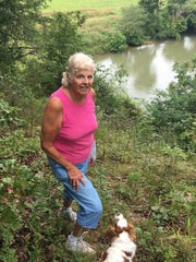 Joy Ochs remembers well the day in 1976 when a stranger's car went over the bluff and disappeared down the hill.